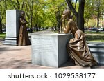 Small photo of BOSTON, MASSACHUSETTSS - MAY 3: Phillis Wheatley and Abigail Adams at the Boston Women's Memorial in Back Bay, Boston, a monument celebrating women's history in the USA. As seen on May 3, 2013.