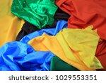 pile of colorful silk fabrics.... | Shutterstock . vector #1029553351