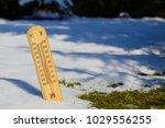 thermometer in melting snow ... | Shutterstock . vector #1029556255