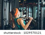 sporty woman training her chest ... | Shutterstock . vector #1029570121