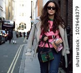 Small photo of LONDON, United Kingdom- February 16 2018: Jessica Wang on the street during the London Fashion Week