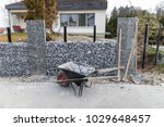parked wheelbarrow full with... | Shutterstock . vector #1029648457