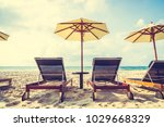 umbrella and chair on the... | Shutterstock . vector #1029668329