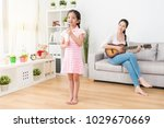 housewife and young little... | Shutterstock . vector #1029670669