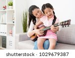 mother teaches daughter how to... | Shutterstock . vector #1029679387