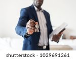 Small photo of Real estate agent handing the house key