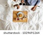 african american couple in bed... | Shutterstock . vector #1029691264