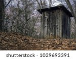 An Old Rustic Outhouse On A...
