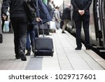 commuters at a train station | Shutterstock . vector #1029717601