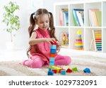 child little girl playing...   Shutterstock . vector #1029732091