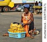 African Street Vendor Sells...