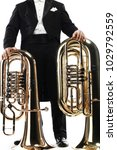 Small photo of Tuba brass instrument. Wind horn music instrument. Orchestra bass euphonium. Classical musician tuba player