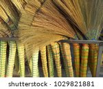 a pile of bamboo brooms in... | Shutterstock . vector #1029821881