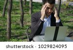 serious collector using laptop... | Shutterstock . vector #1029824095