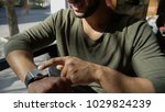 arab guy sits in caf and... | Shutterstock . vector #1029824239