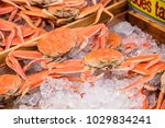 fresh crabs on ice at kuromon... | Shutterstock . vector #1029834241