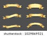set of glowing golden vector... | Shutterstock .eps vector #1029869521