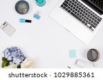 female workspace with laptop ... | Shutterstock . vector #1029885361