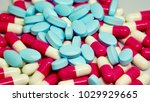red and white capsules  blue...   Shutterstock . vector #1029929665