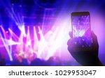 hand holding smartphone records ... | Shutterstock . vector #1029953047