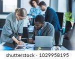 businesswoman writing something ... | Shutterstock . vector #1029958195