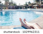 feet of the girl in the pool ... | Shutterstock . vector #1029962311