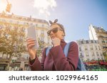 woman using cellphone and... | Shutterstock . vector #1029964165