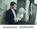 guy smiles a big plush toy.... | Shutterstock . vector #1029964501