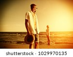 two lovers on beach and summer... | Shutterstock . vector #1029970135