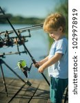 child smile with fishing rod on ... | Shutterstock . vector #1029978919