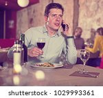 glad man talking on phone... | Shutterstock . vector #1029993361