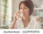 middle aged woman drinking water | Shutterstock . vector #1029993955