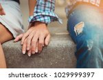 Stock photo a young couple in love touched hands on the first date loving couple has a happy relationship 1029999397