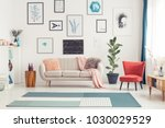 red chair and blue carpet near... | Shutterstock . vector #1030029529