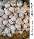 dried garlic in bamboo basket | Shutterstock . vector #1030043929