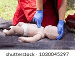 paramedic performing cpr on... | Shutterstock . vector #1030045297