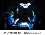 doctor operating in operation... | Shutterstock . vector #1030061134
