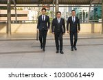 boss is walking with his... | Shutterstock . vector #1030061449
