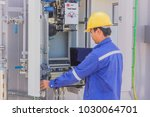 employees are monitoring the... | Shutterstock . vector #1030064701
