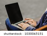 male holding notebook on knees... | Shutterstock . vector #1030065151