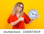 woman in dress with clocks | Shutterstock . vector #1030073419