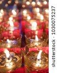 oil lanterns in buddhist temple ... | Shutterstock . vector #1030075237