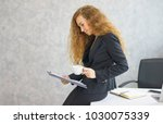 business woman looking at... | Shutterstock . vector #1030075339