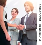 businesspeople  shaking hands... | Shutterstock . vector #1030084819