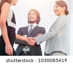 businesspeople  shaking hands... | Shutterstock . vector #1030085419