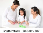 kid girl father and mother... | Shutterstock . vector #1030092409