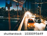 yellow cabs and cars moving by... | Shutterstock . vector #1030095649