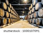 plenty of porto wine barrels in ... | Shutterstock . vector #1030107091