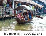 Small photo of Bangkok, Thailand - Feb 11, 2018: Tourists enjoy traveling by tourist row boat on Lad Mayom canal.