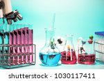 microscope and laboratory test... | Shutterstock . vector #1030117411